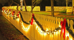 """<img src=""""fence with lights.png"""" alt=""""fence decorated with lighted Christmas garland"""">"""