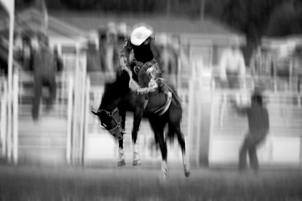 bigstock-Cowboy-riding-bucking-bronco-a-