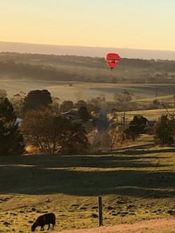 Balloon on the horizon early morning