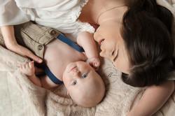 Mom Boy Laying Down Bed Tan Motherhood