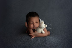 Newborn Baby Boy Froggy Black African American on Blue Backdrop Holding White Teddy Bear