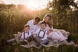 Family of 4 Blanket Sitting Sunset Outdo