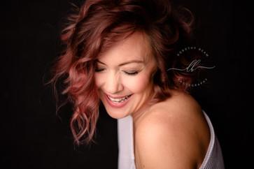 Woman Laughing Off the Shoulder Portrait