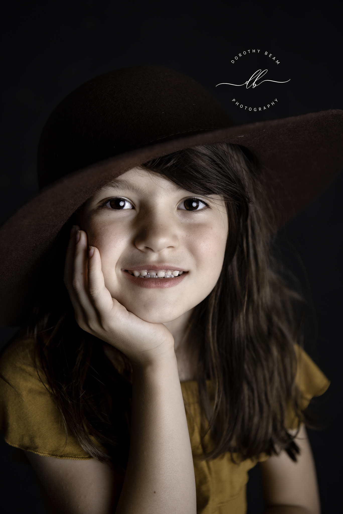 Girl Black Brown Hat Hand on Face Close