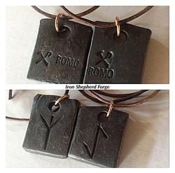 Pair of rune pendants