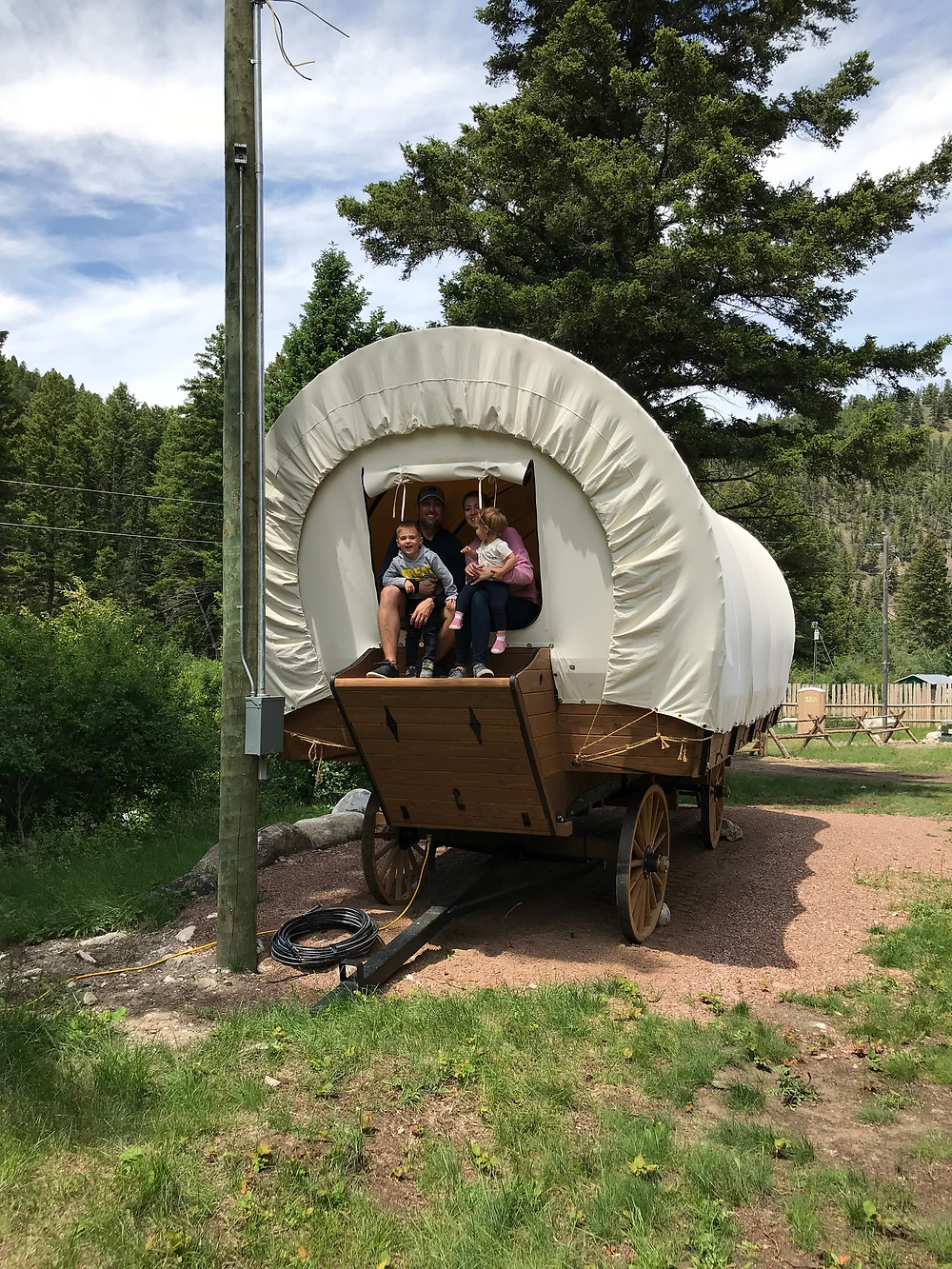Glamping Conestoga wagon at Boulder Creek Lodge