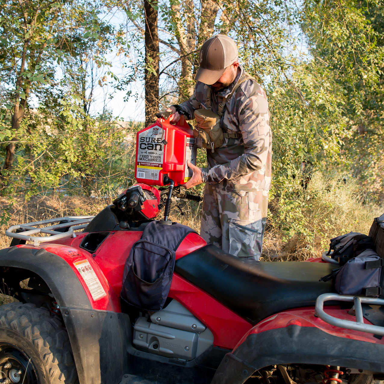 The SureCan allows  you to place it on top of the handlebars of your ATV and rotate the spout 180 degrees down into the tank you are filling so that you won't have to hold the weight of your gas can while you feed it.
