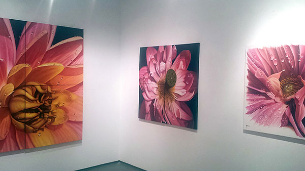 Paintings of flowers at an exhibition