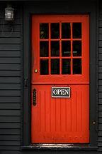 Open sign on red door in Massachusetts v