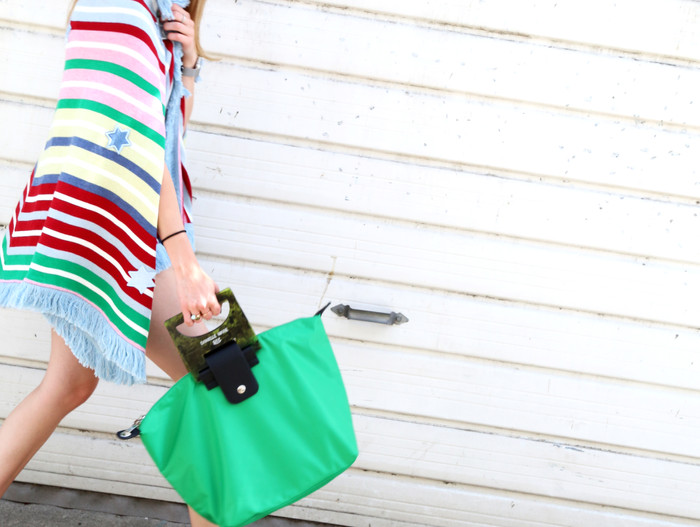 Here Is Proof That You Can Wear A Knit Poncho For Spring, Too.