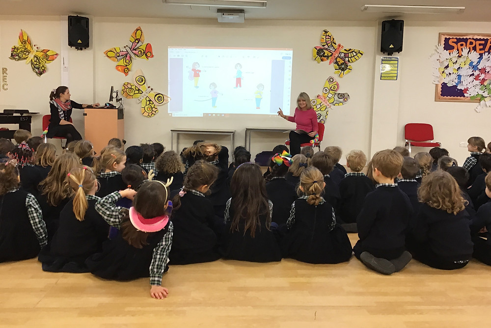 Cate Douglas reading Poppy's Tail in school