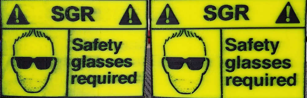 3d Printed signs, print on the right is much cleaner
