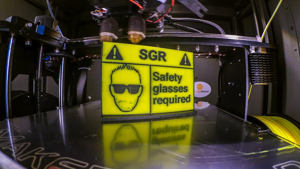 3d printed logo still on 3d printer