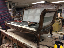 Un-upholstered without broken arm