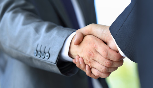 handshake in office.jpg