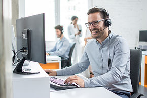 Smiling customer support operator with h