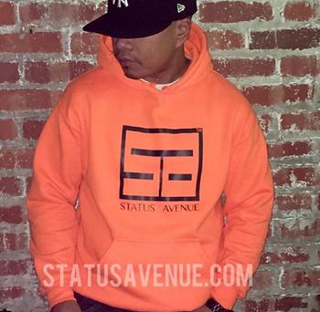 STATUS AVENUE CUSTOMER wearing orange mens hoodie with logo