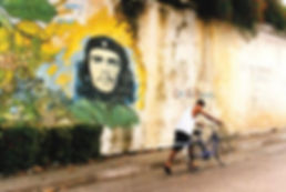 Wall mural with a cyclist passing by in Cuba