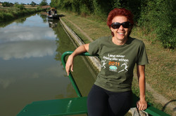 Relaxing work on canal boat England