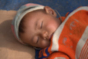 Sleeping Hmong child at a market in North Vietnam