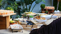 Array of Buffet Items with Leaf Backdrop