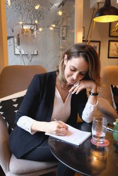 Anastasia taking notes