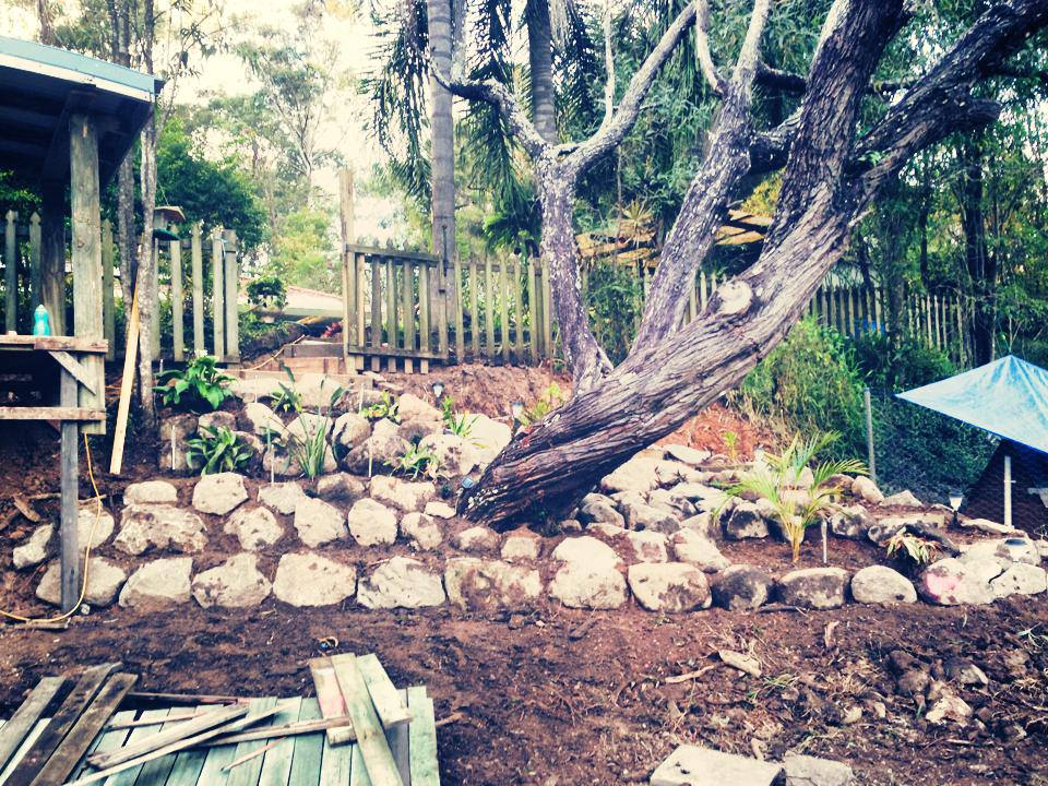 Rock wall with Garden Beds