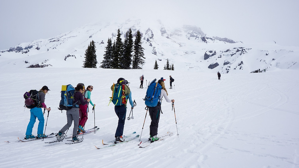 Jenny Konway of Mountain Madness Guides leading the SheJumps group up towards the Nisqually Glacier on Mount Rainier.