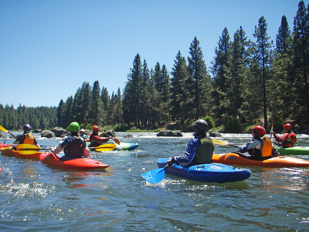 SheJumps and Tumalo Creek Kayak and Canoe teaching ladies basic whitewater paddling strokes