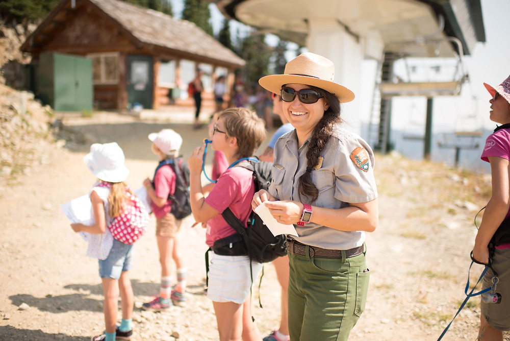 Ranger Annie teaches participants about wildlife viewing at the top of Green Valley.