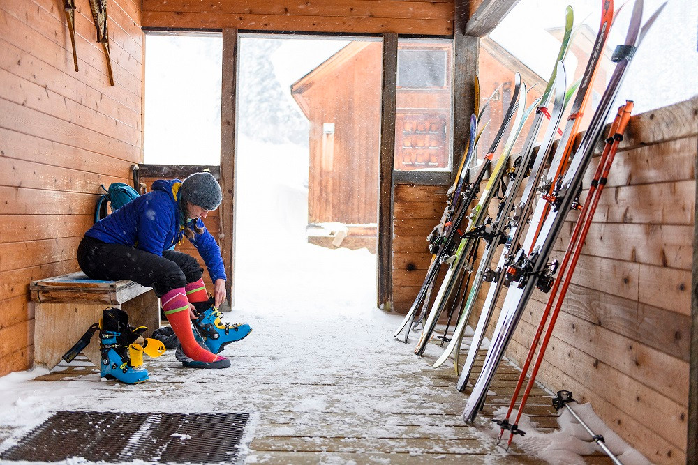 Shireen Marshall putting on the boots for antoher day of ski touring from
