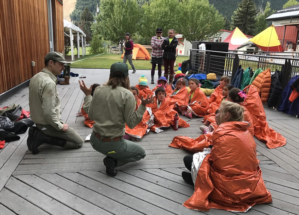 National Forest Wilderness Rangers, Chris Snell and Chelsea Phillippe teach girls  how to stay warm