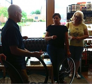 Tim Krone leads some KZoo women through changing a flat.