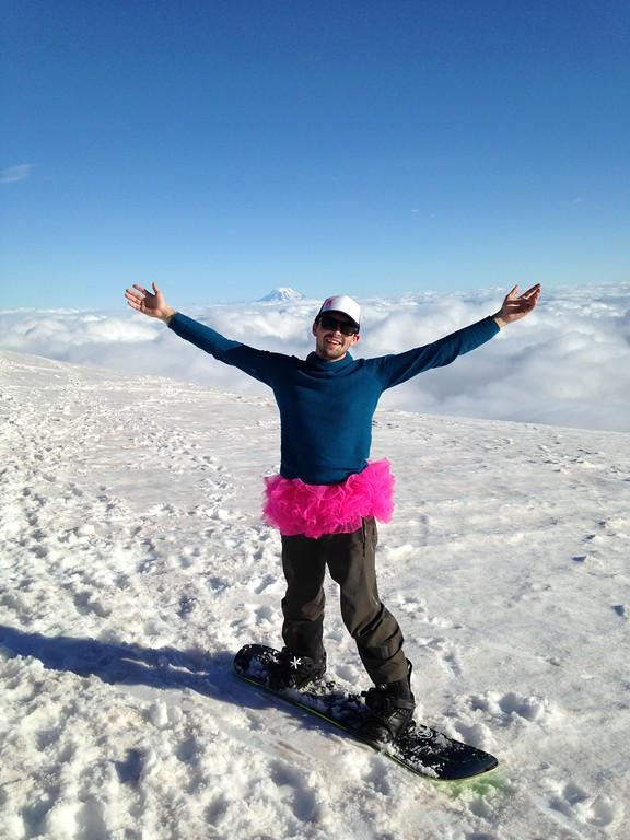 Max on snowboard with tutu