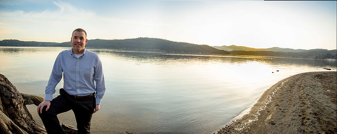 Paul Amador standing on the shore of Lake Coeur d'Alene