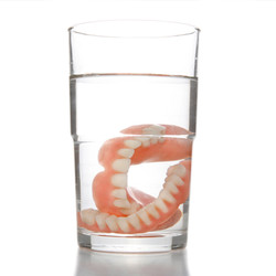 False teeth having a swim in transparent