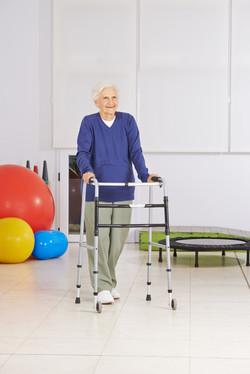 Happy senior woman with walker exercisin