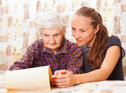 Young sweet lady holds the elderly woman