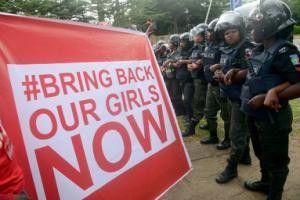 Supporters of the #BringBackOurGirls campaign hold …