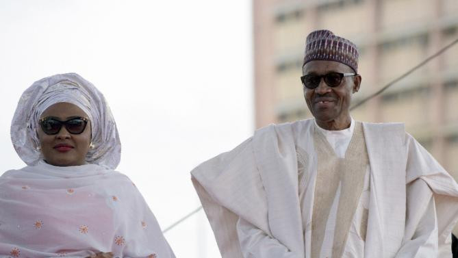 Nigerian President Mohammadu Buhari arrives at his inauguration with his wife Aisha before taking oath of office in Abuja, on May 29, 2015