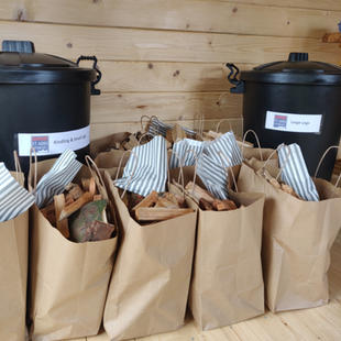 Fire pit packs and top up bins