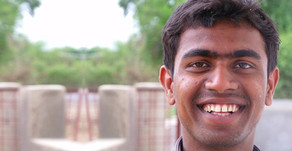 A young postman who is a part-time social Entrepreneur