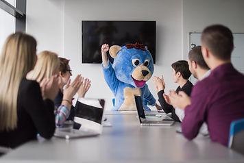 Boss dresed as teddy bear having fun wit