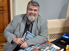 Brian with books-crop.jpg