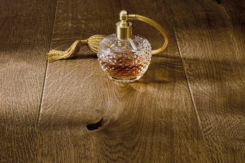 Natural Brown Oak Engineered Timber Flooring with Bottle of Perfume