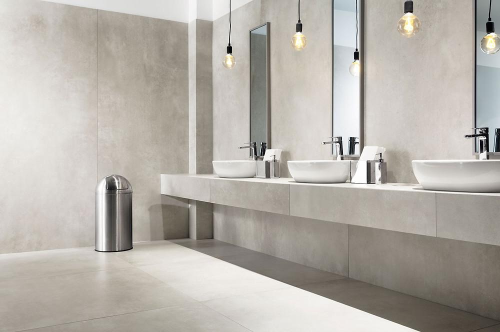 Public bathroom tiled with Large Format Tiles Epoxy Grey Matt1200x1200mmand 2400x1200mm