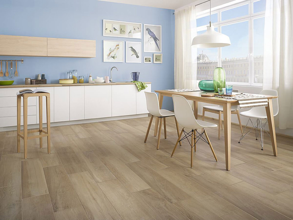 Wood-like tiles in a living room and dining room and a kitchen. Maloe Collection, Ceramika Paradyz.