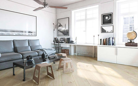 Bright Scandinavian Style Room with Wide White Oak Floor Boards and Grey Couch