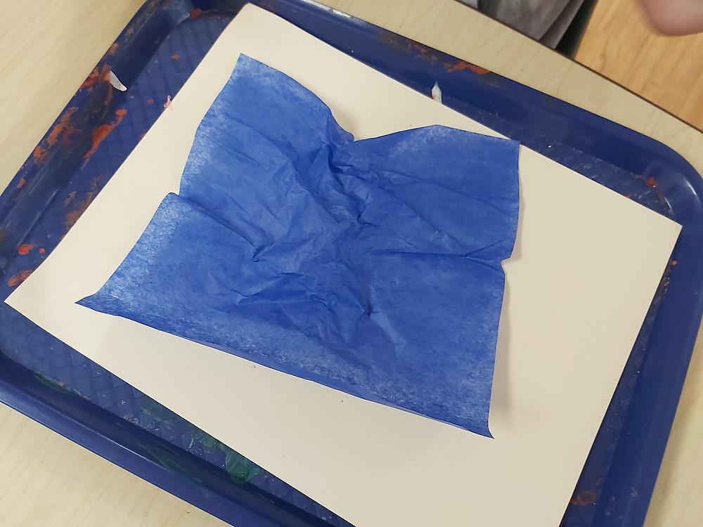 blue tissue paper on cream cardstock