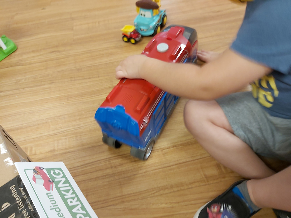 preschooler pushing toy car